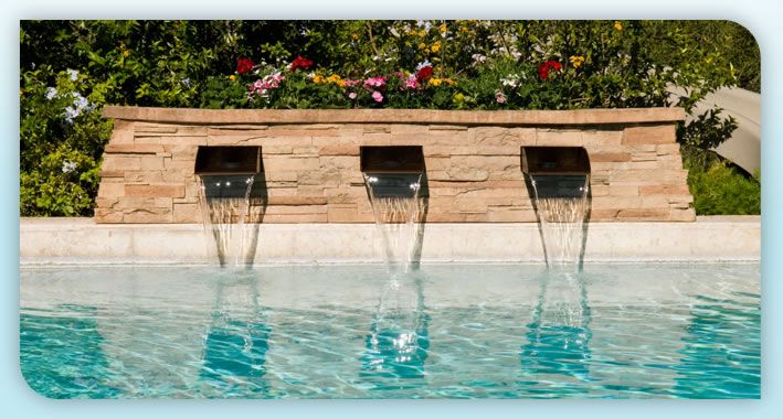 Trinity falls waterfall features an integrated planter for Swimming pool waterfalls construction