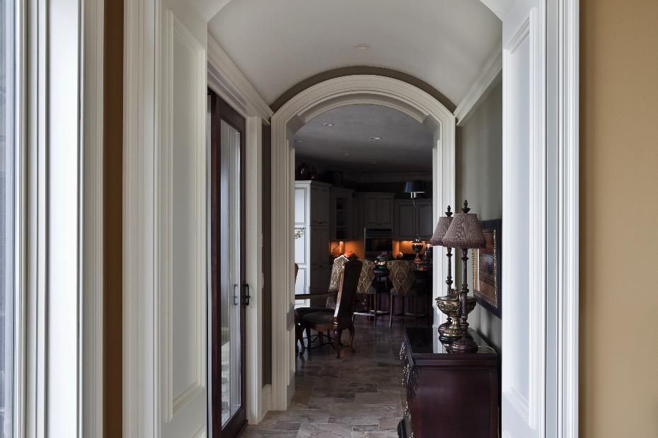 Sophisticated hallway with arched doorways. Cost details for this new home construction available.