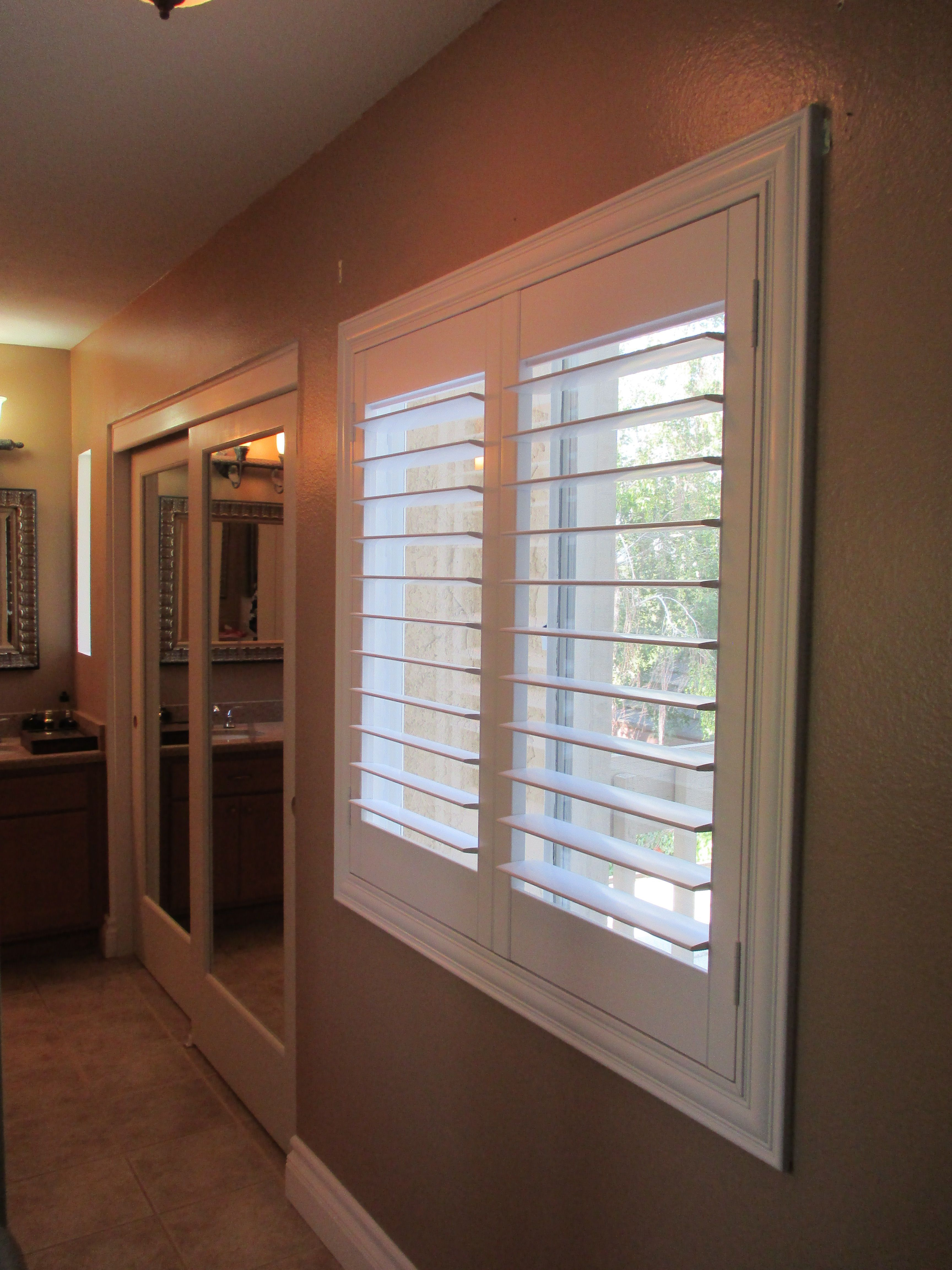 Sliding window over kitchen sink  inside sliding doors master bath create eyecatching brighter