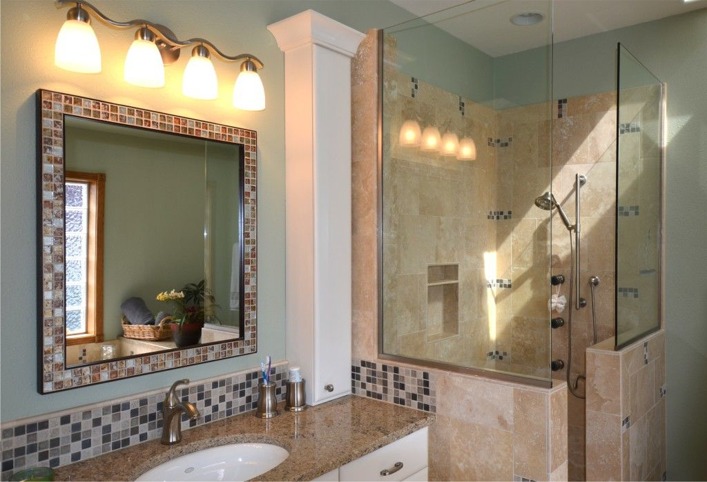add your backsplash mosaic as a border around the mirror ...