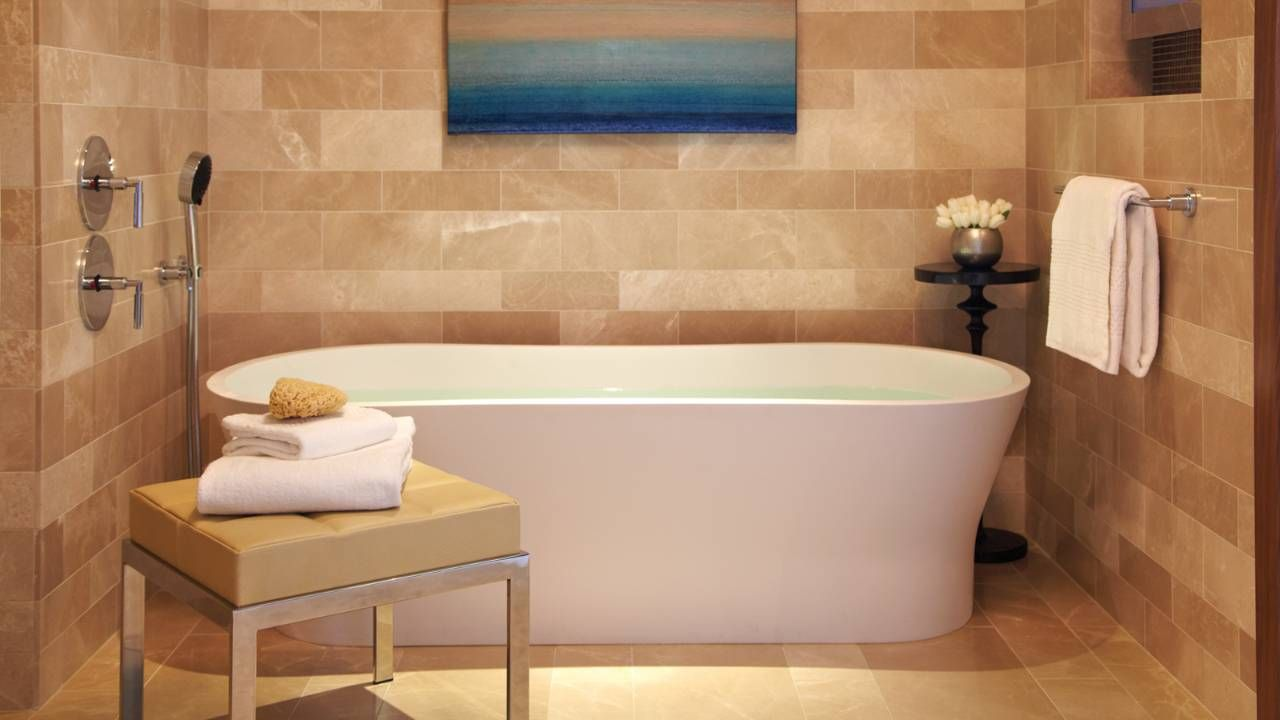 Indulge In Seasons Hotel Baltimoreu0027s Luxurious Soaking Tub Or Refresh In  The Oversized Glass Walled Walk In Rain Shower. The Full Marble Bathroom  Delights ...