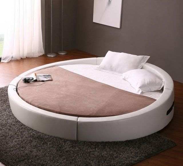 bearing a minimally designed low profile look the opus modern round leather bed is - Lowprofilekopfteil