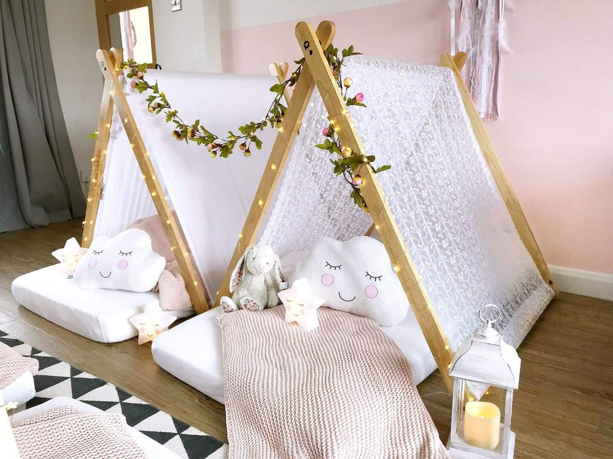 How To Create A Magical Teepee Sleepover Party - Teepee party, Sleepover tents, Sleepover party, Sleepover, Girls slumber party, Birthday sleepover ideas - Looking for a kids party with a difference  Find out how to create a magical sleepover teepee party with wooden play tents, fairy lights and cushions