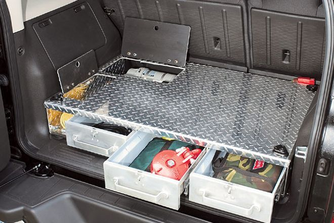 Cargo-area drawers make the most of the H3's storage space ...