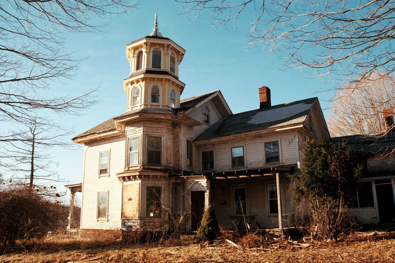 Abandoned Connecticut house with yellow tower.