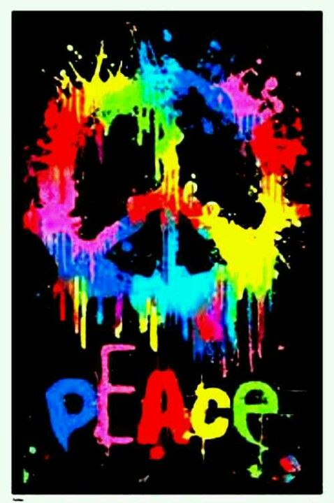 """THIS PEACE SIGN HAS A LOT OF DIFFERENT COLORS PAINTED TOGETHER, AND THE WORD """" PEACE"""" IN LETTERS OF DIFFERENT COLORS."""