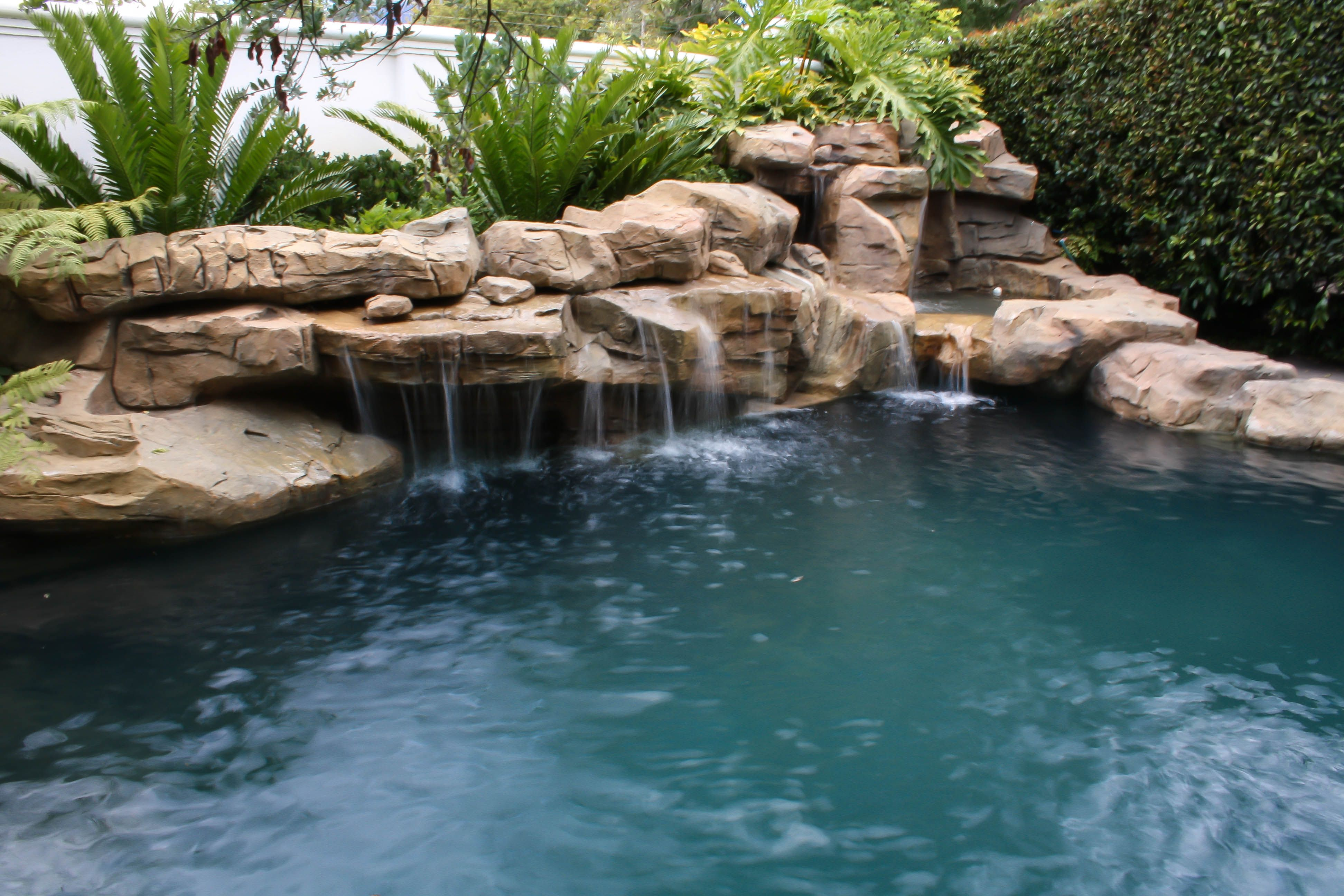 Rock Sculpture With Multiple Cascading Waterfalls Pool Landscaping Pool Waterfall Backyard Pool