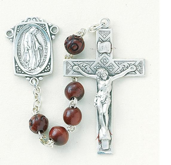 """6x9mm Maroon Oval Genuine Cocoa Beads with Carved Our Father Beads. Sterling Silver Miraculous Center and a 2"""" Sterling Silver Crucifix with Rhodium Plated Find"""