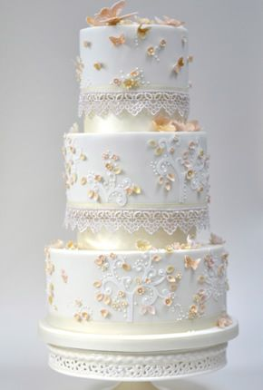 I LOVE the design of this cake. It's got an elegance to it, yet still has a carefree feel. I wonder how it would look if we incorporated our wedding colors....