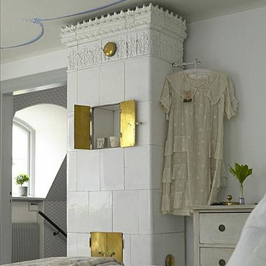 Scandinavian interior design is one of my absolute favorite decorating styles, and one standout feature in many Scandinavian homes is the traditional stove that regally occupies a corner of a bedroom or living room. Most Scandinavian stoves are