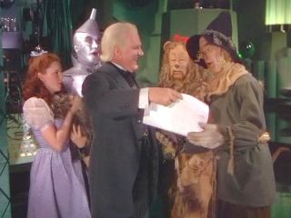 Picture of Wizard giving Scarecrow his Diploma