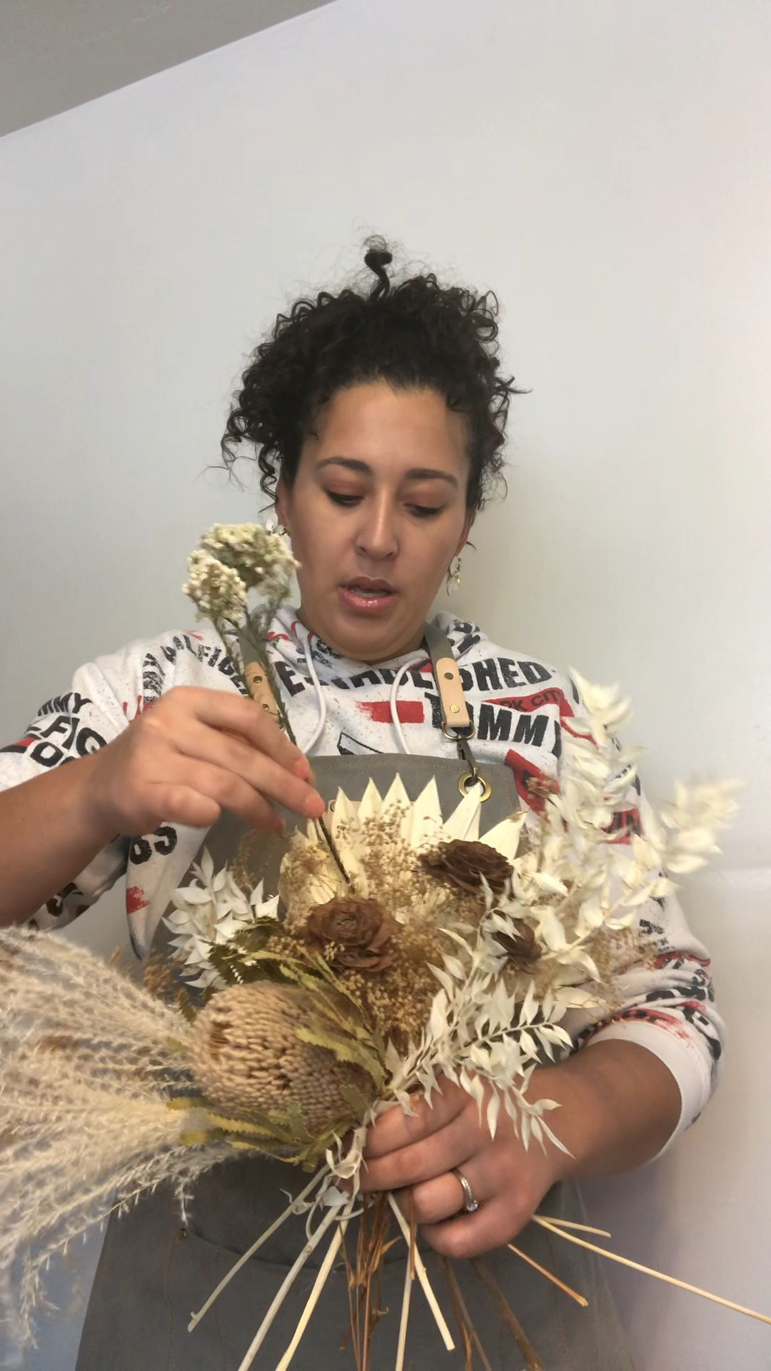 Learn how to make a natural dried bridal bouquet made to last for years to come! #driedflowers #dried #dying #bridalbouquet #pampas #flowers #weddingideas #weddingflowers #keepsake