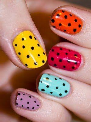 Multi colored polka dots nail design