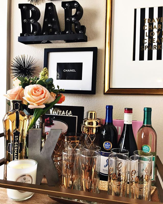 Current bar cart situation: a little messy but flower game is strong Shop the cart here: [www.liketk.it/28Q4r] #liketkit @liketoknow.it #barcart #ltkhome #barcartstyling