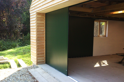 Sliding And Folding Doors Timber And Commercial Sliding Garage Doors Sliding Garage Doors Folding Doors Garage Doors