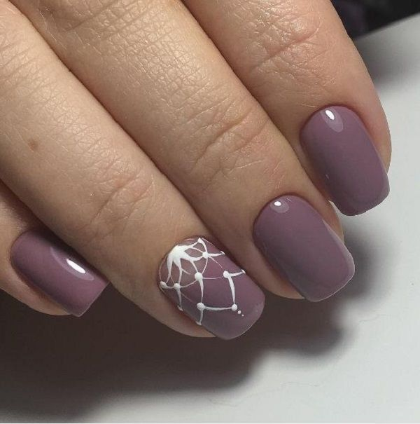 Plum Colored Winter Nail Art Design The Nails Are Painted With Polish Color And On Top Is A Crown Like Detail In White To