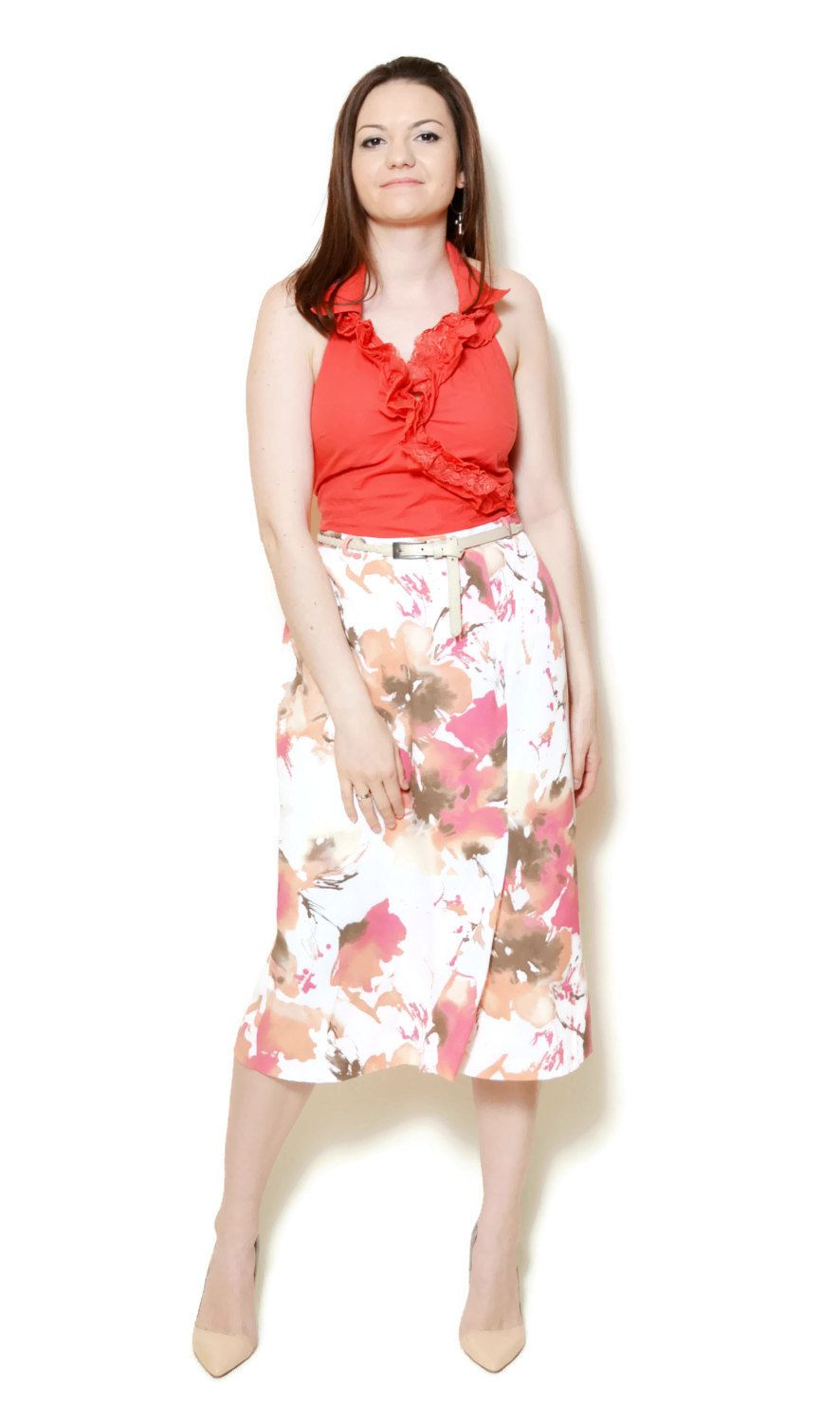 Vintage colorful floral midi skirt. The model on the pictures is size S/36 and 165 cm height. Please check measurements with your own to avoid problems with the size. Make sure you double the measurements where shown (*2):  Label size: L/40 Total lenght: 73 cm / 29 inches Waist: 40.5 cm *2 / 16 inches *2 Hips: 55 cm *2 / 21.5 inches *2 open Bottom Width: 61.5 cm *2 / 24 inches *2 Condition: very good Colors: White, Beige, Brown, Orange, Pink Circa: 90s Fabric: 10...