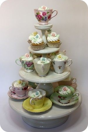 A pretty display of cupcakes in teacups!