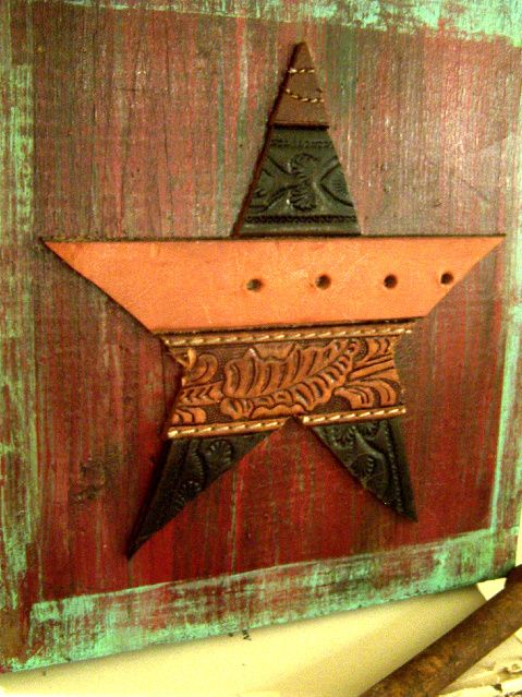 old tooled leather belts=rustic star