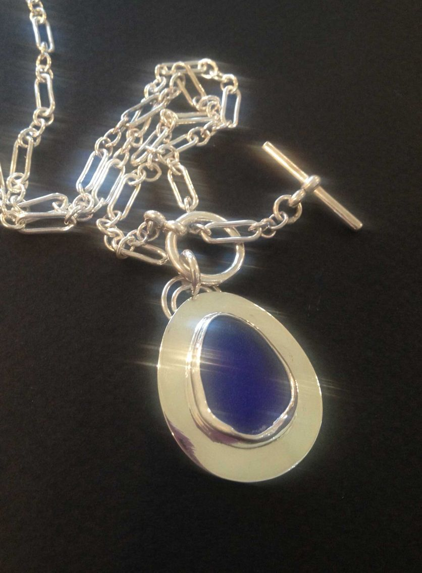 Cobalt blue sea glass bezel set pendant in sterling silver with