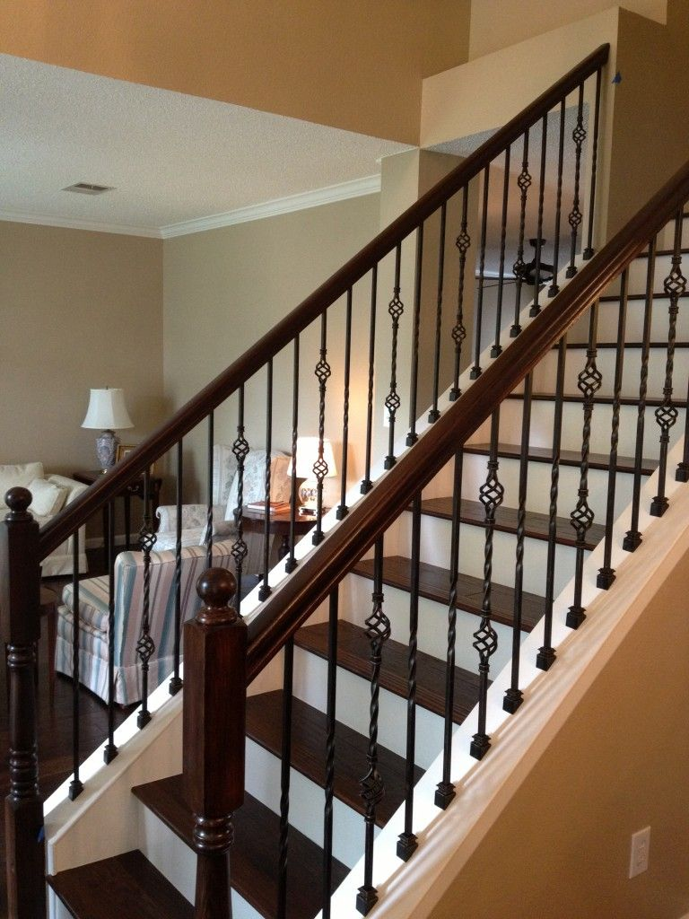Wrought Iron Balusters at Stairs with Wood Treads