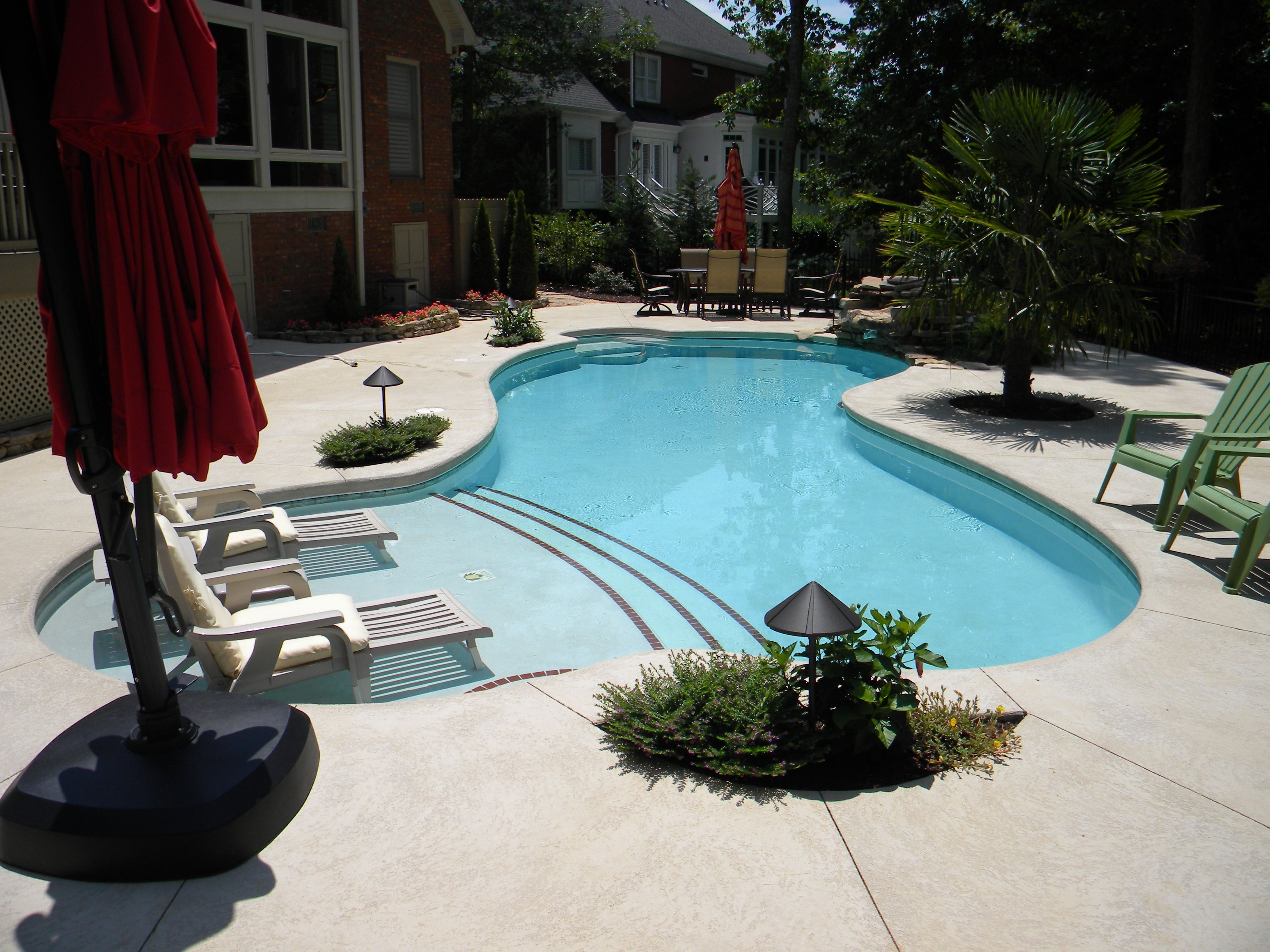 Residential swimming pool in Greenville SC with a sun deck