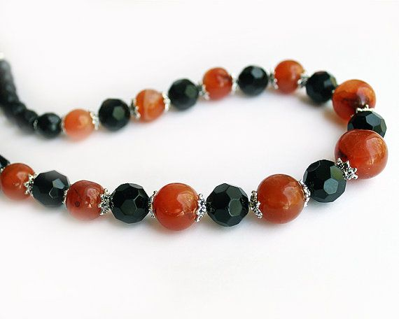 Hey, I found this really awesome Etsy listing at https://www.etsy.com/listing/187739243/orange-and-black-carnelian-necklace