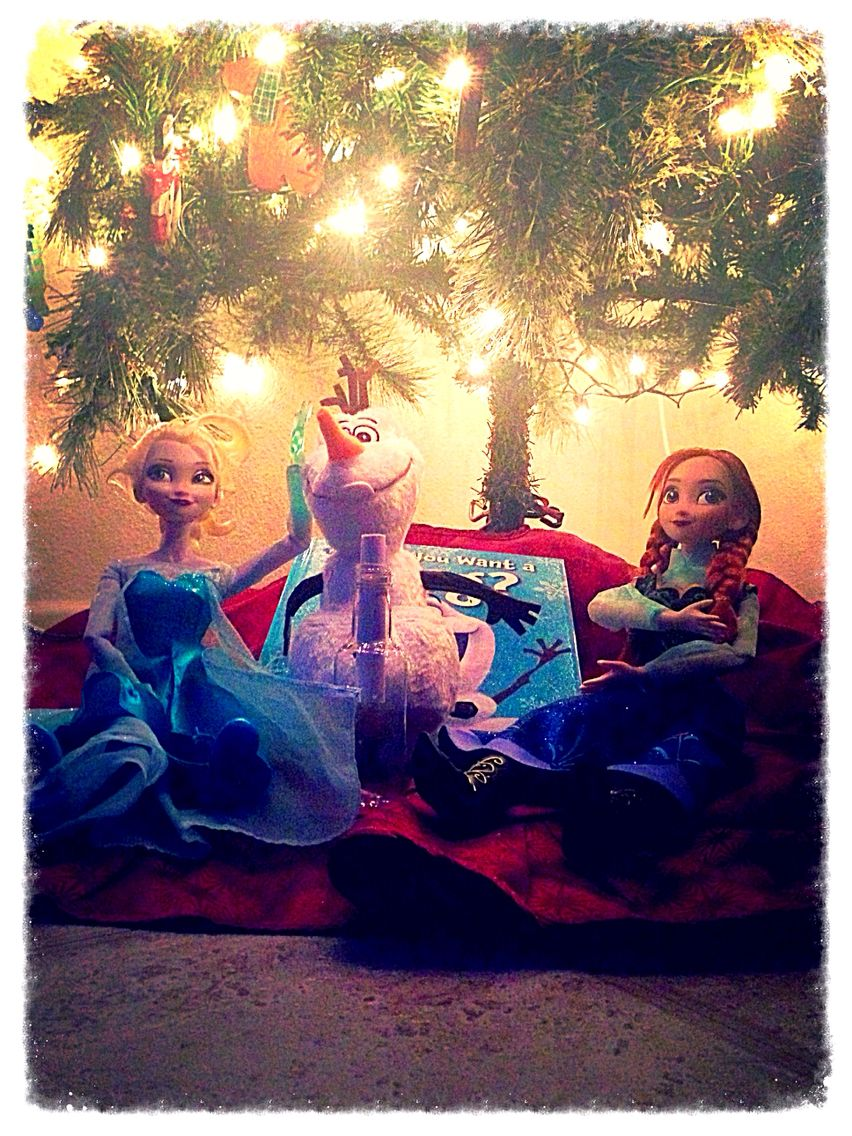 """Olaf, Queen Elsa and Princess Anna ready to greet on the first day of December.  The note in the bottle says """"Hi I'm Olaf and I like warm hugs.  Thank you for letting me in your home!!"""""""