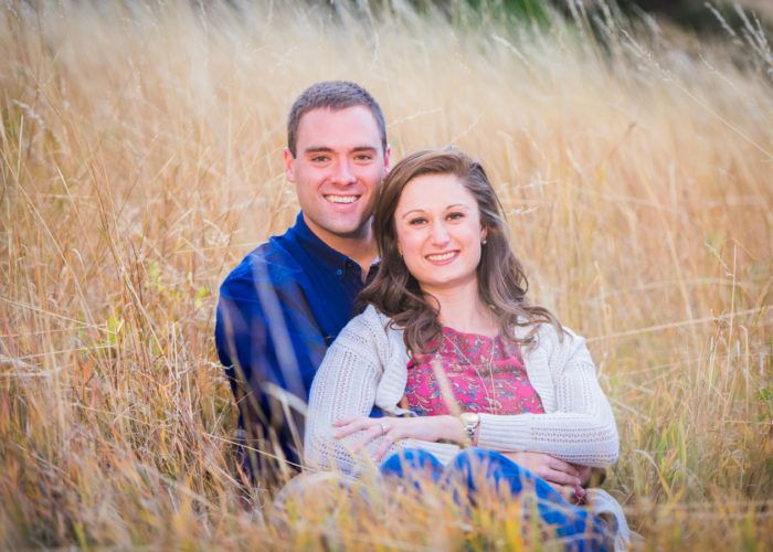 NCAR Fall Engagement Session Laying in Grass