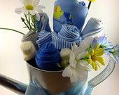 Baby boy onesie bouquet in watering can for baby shower decor or baby shower gift