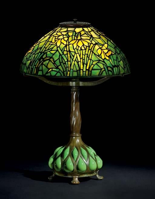 """Tiffany Studios, New York, Favrile Leaded Glass and Patinated Bronze """"Daffodil"""" Lamp."""