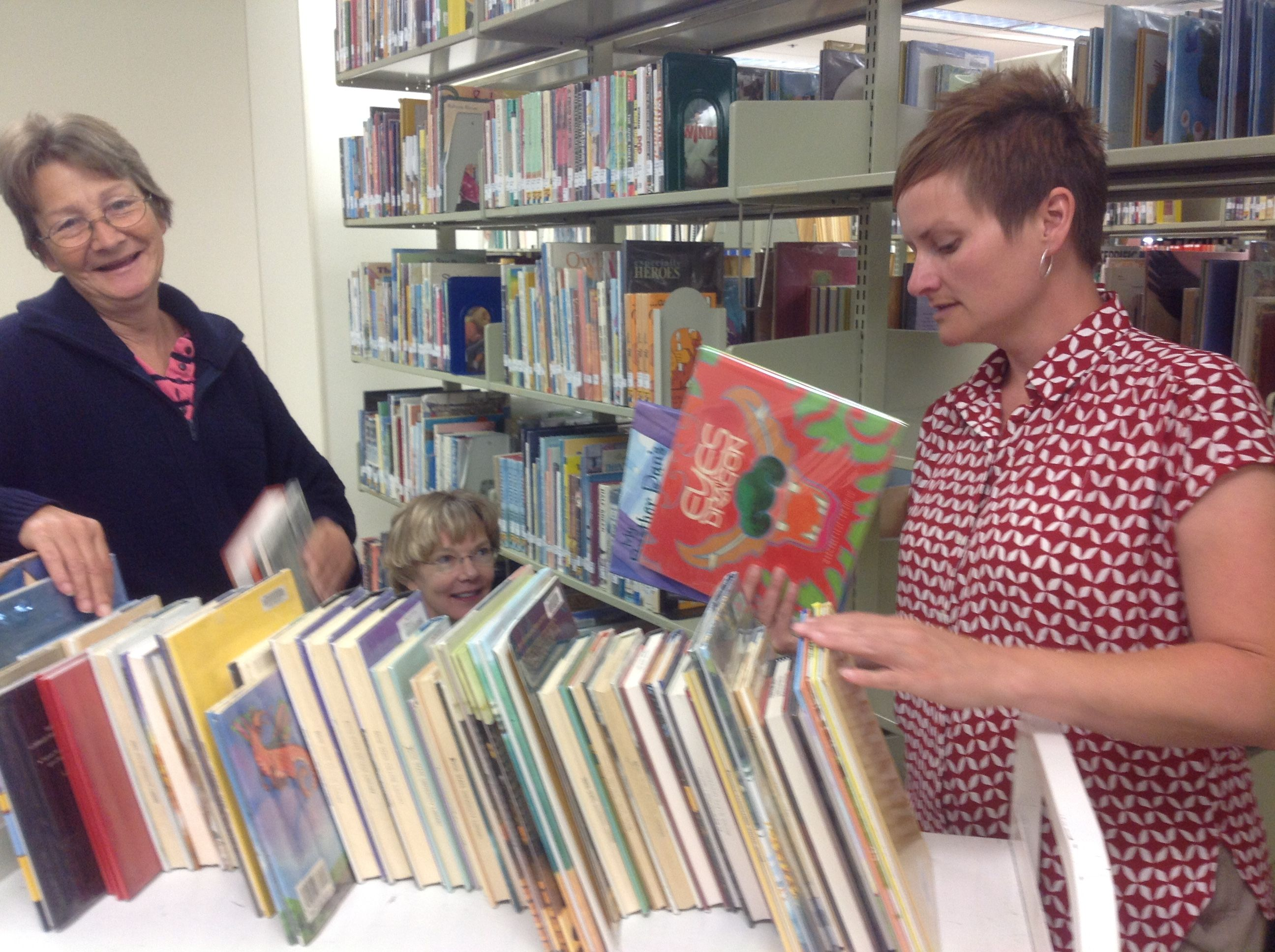 Shelly, Mary, and Margie helped get the Curriculum Resource Center shifted