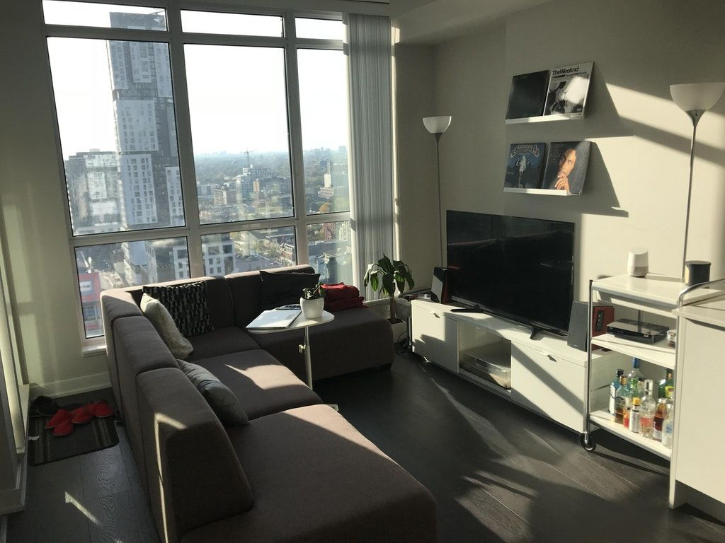 My Downtown Toronto Living Room First Time Living Alone And Loving It Malelivingspace Toronto Apartment Downtown Living Downtown Apartment First time living alone