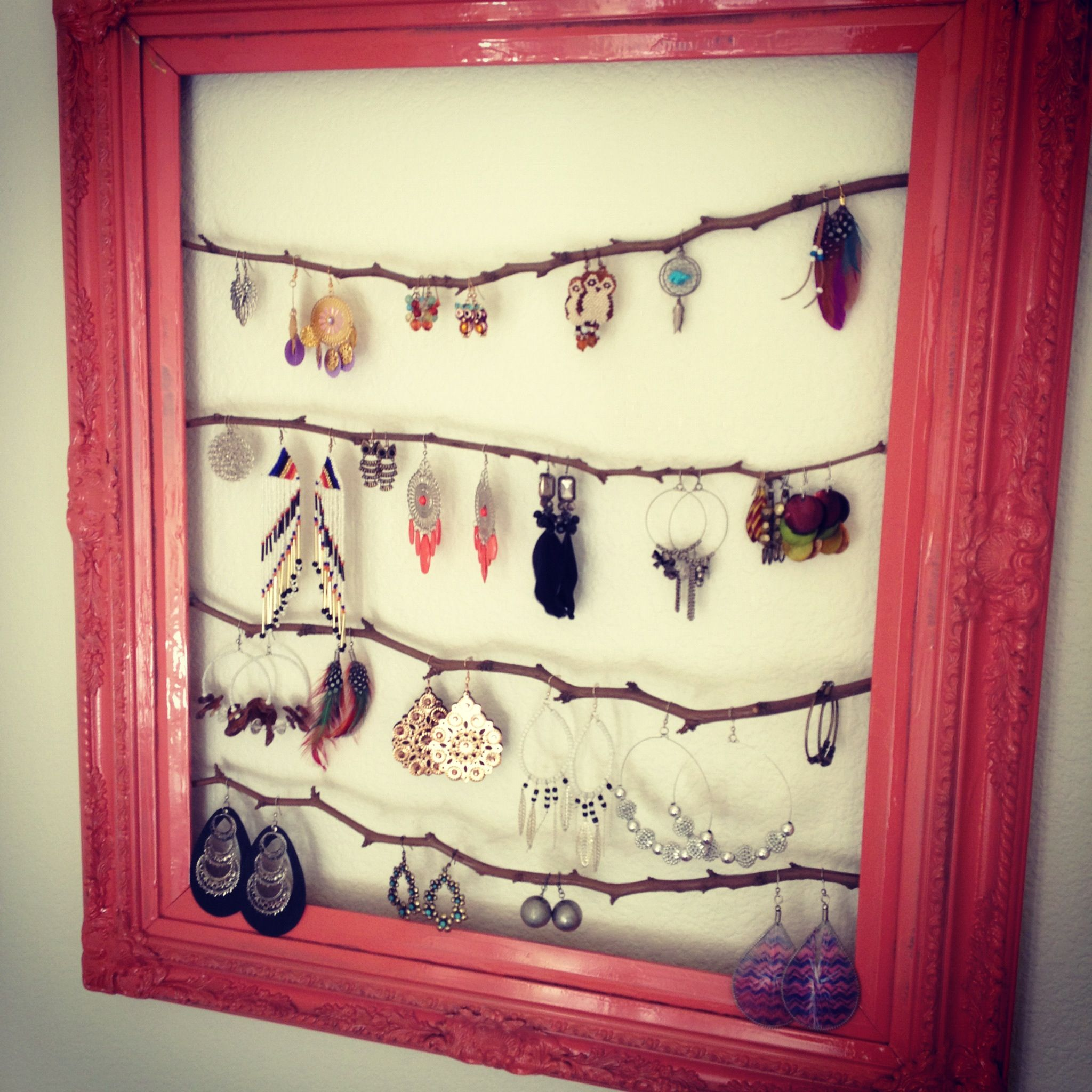 Spray painted a tacky gold frame and hotglued thin tree branches to ...