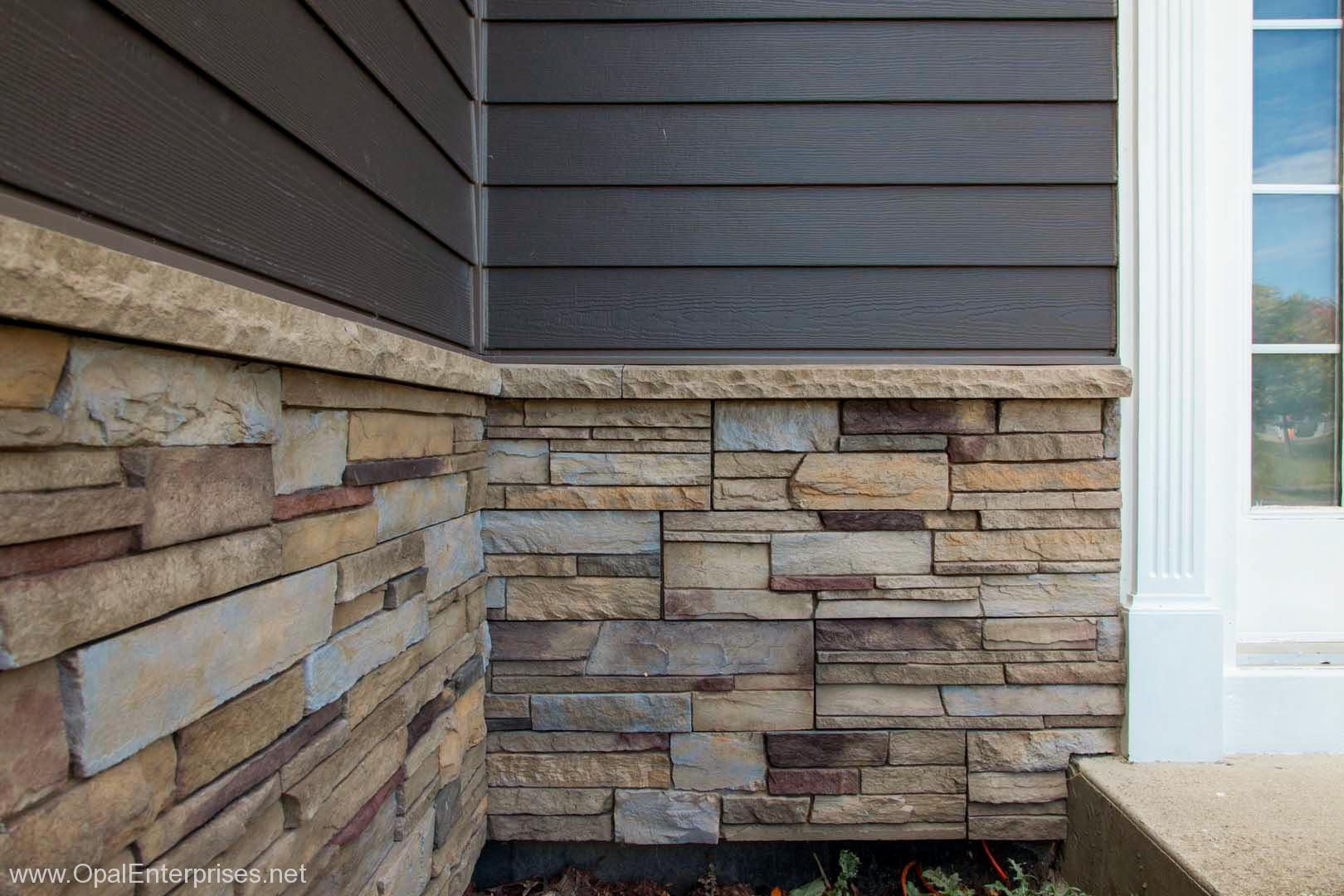 Plum creek versetta stone siding with rich espresso james for Rock siding on house