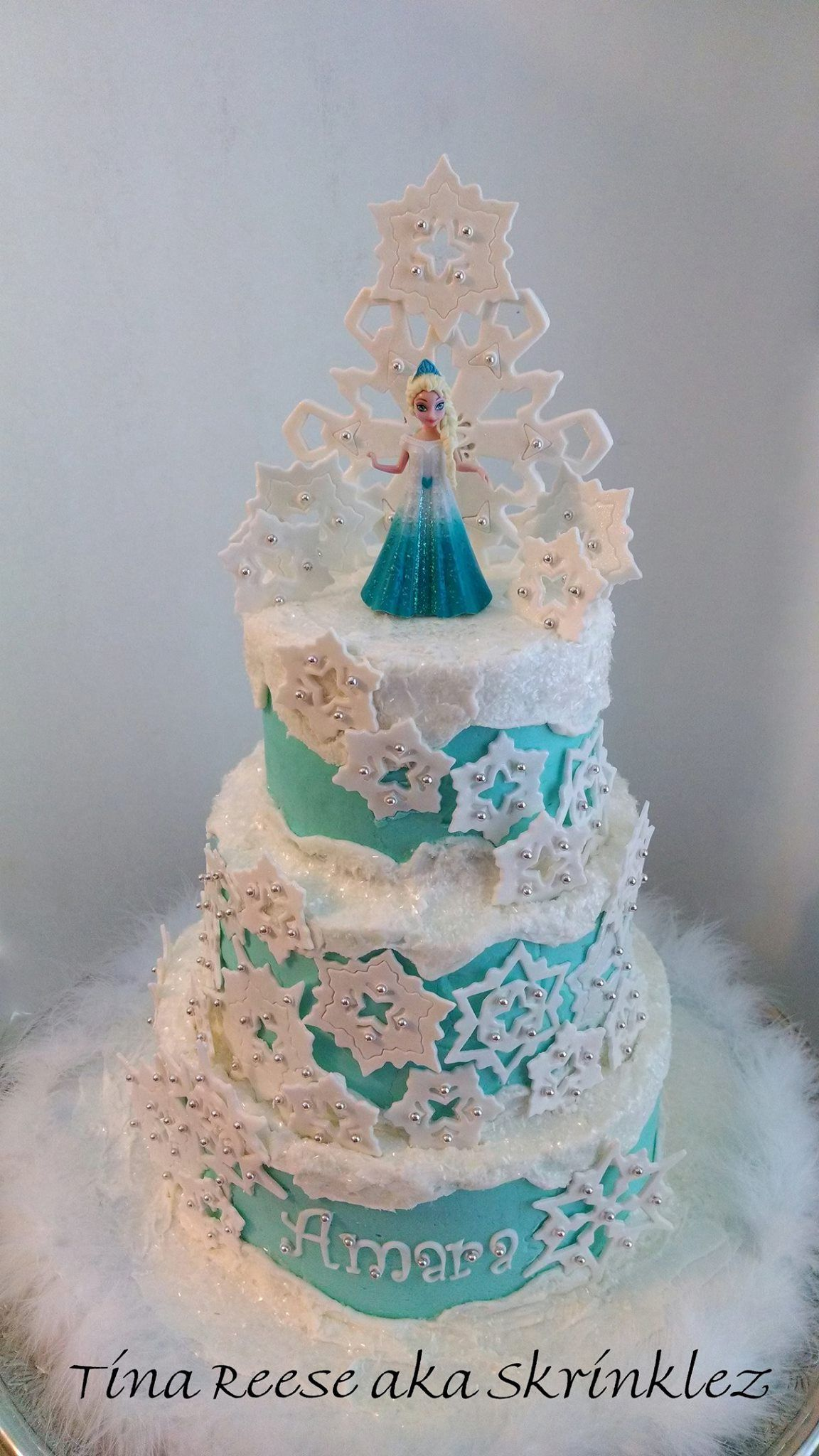 Disneys Frozen Cake iced in buttercream snowflakes and topper