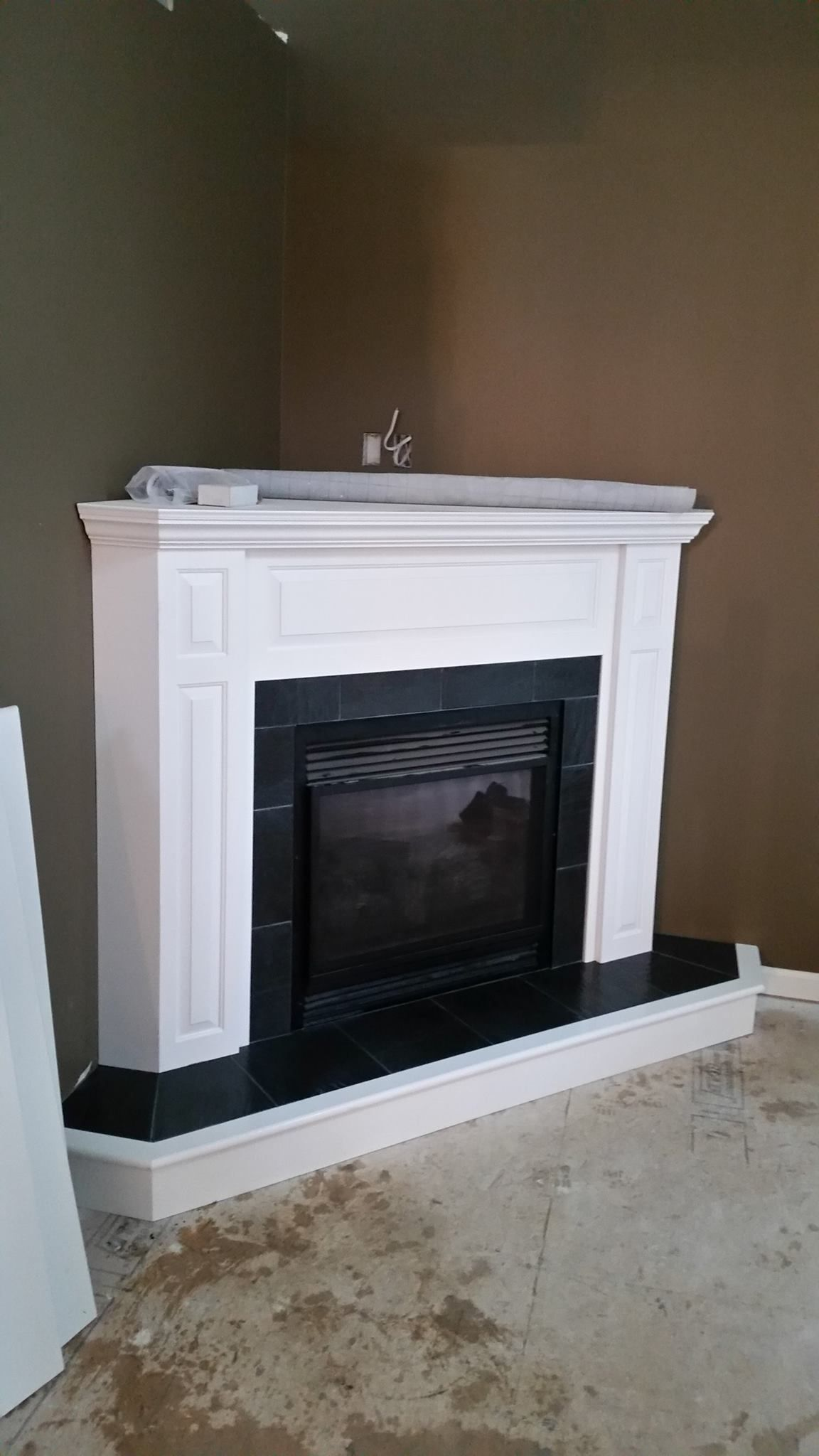 fireplace slate. A black slate tile fireplace surround with white mantle  So What a modern look