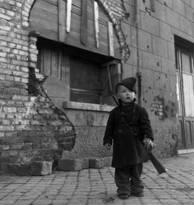 HOLLAND. Town of Walcheren. Boy pretending to be a soldier. 1945.