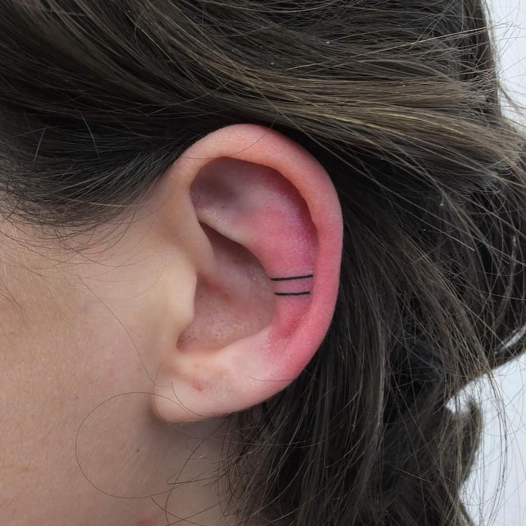 Ear piercing artist  Ear Tattoos Are The Coolest Accessories If Youure Not A Commitment