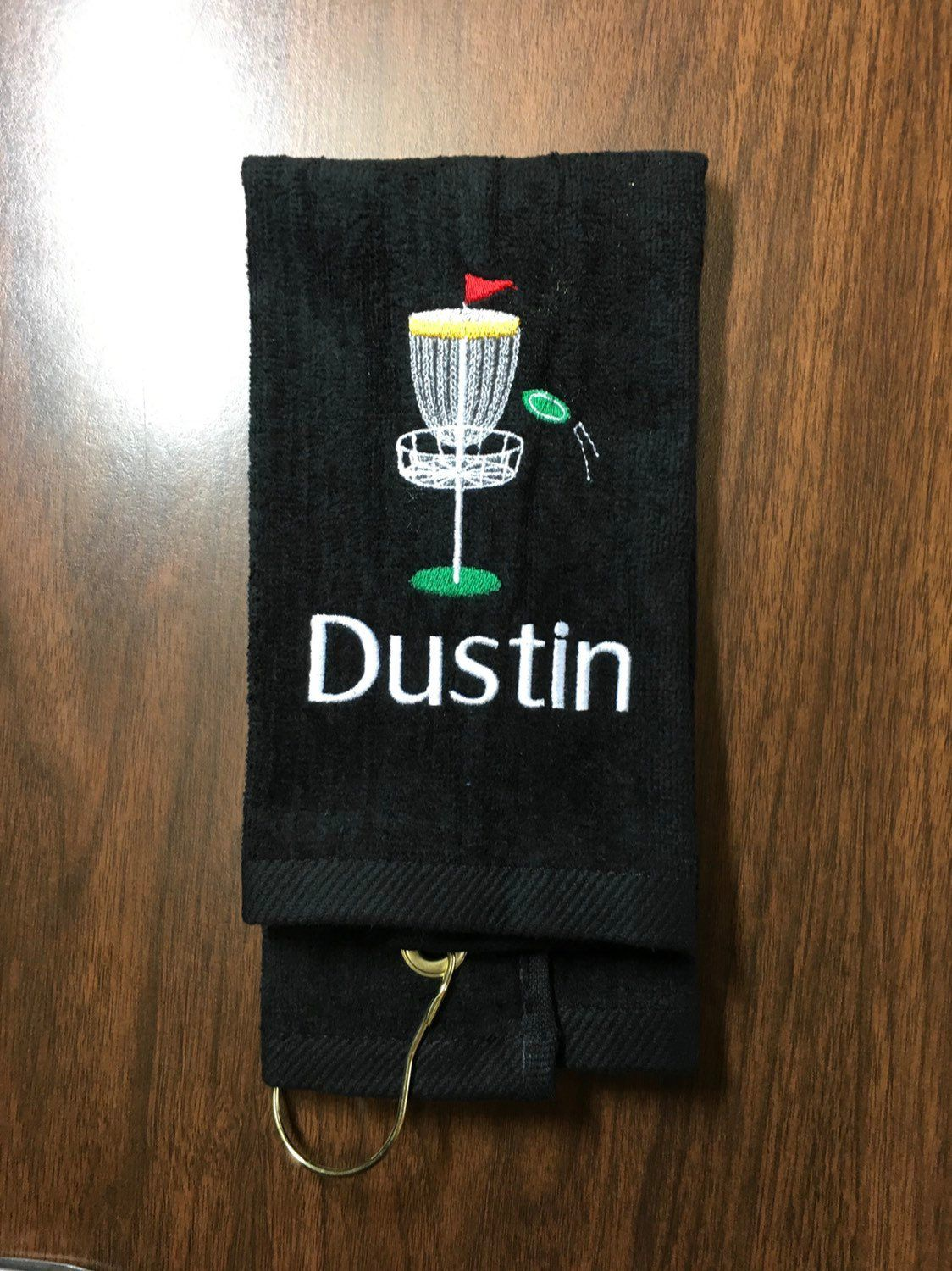 Disc golf towel with custom embroidery and corner hook