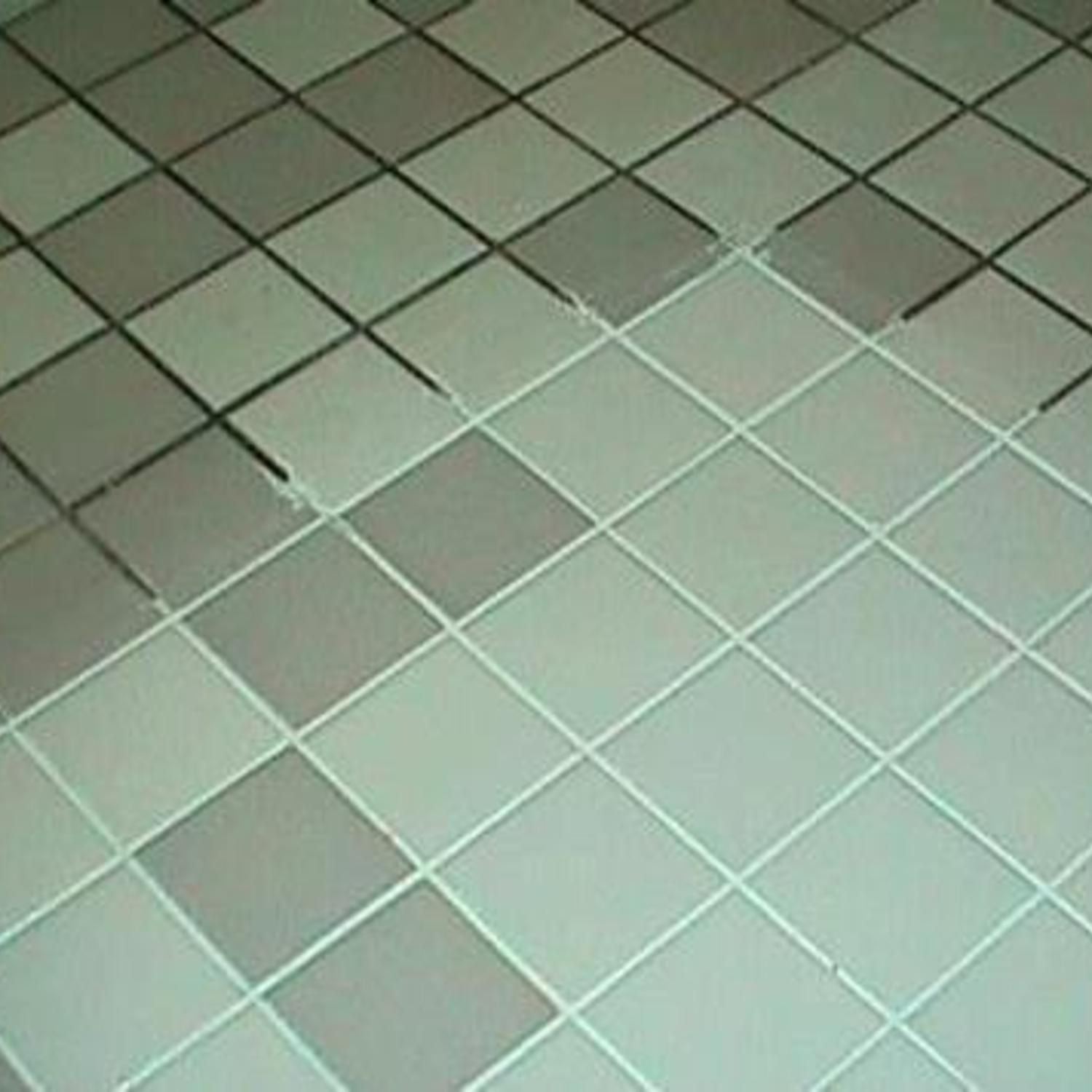 DIY Grout Cleaner Grout Cleaner Combine 7 cups water, 1/2 cup baking soda, 1/3 cup lemon juice and 1/4 cup vinegar - in a spray bottle and spray your floor, let it sit for a minute or two... then scrub!