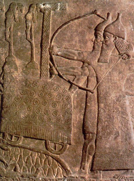 Assyrian bas relief stone carving showing assault on a