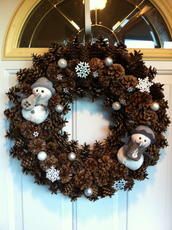 Snowman Pinecone Christmas Wreath.   Val, Cindy and I made these years ago.