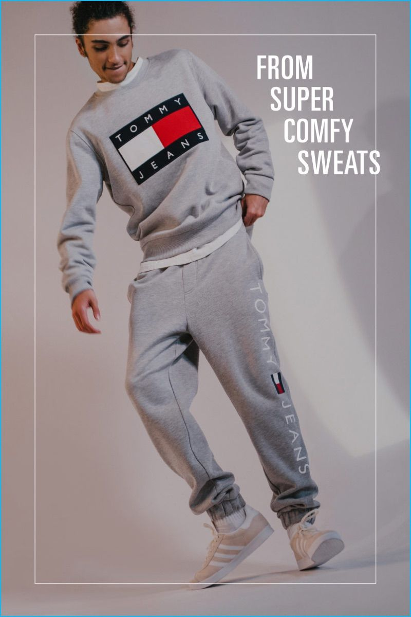 Going sporty, Tre Samuels wears a sweatshirt and sweatpants from Tommy Jeans for Urban Outfitters.