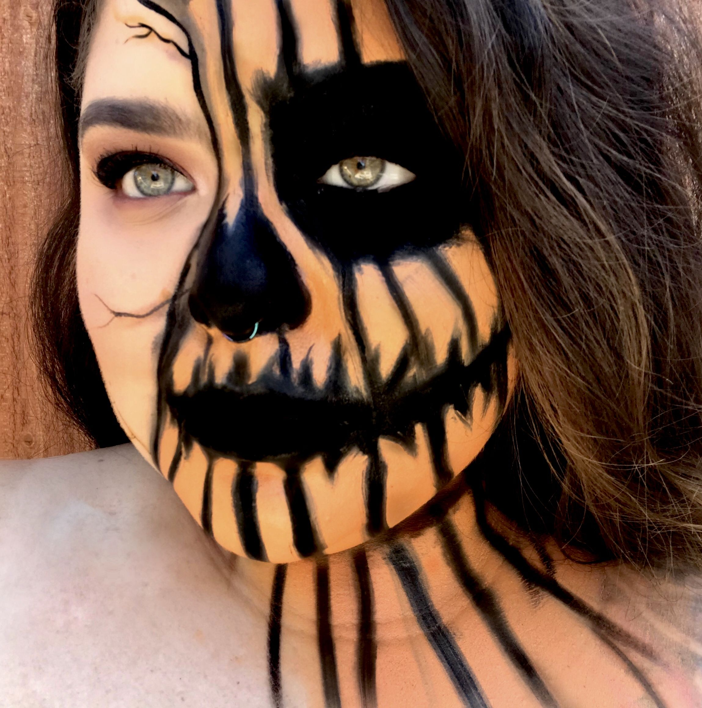 Half skull half pumpkin Halloween makeup Face painting