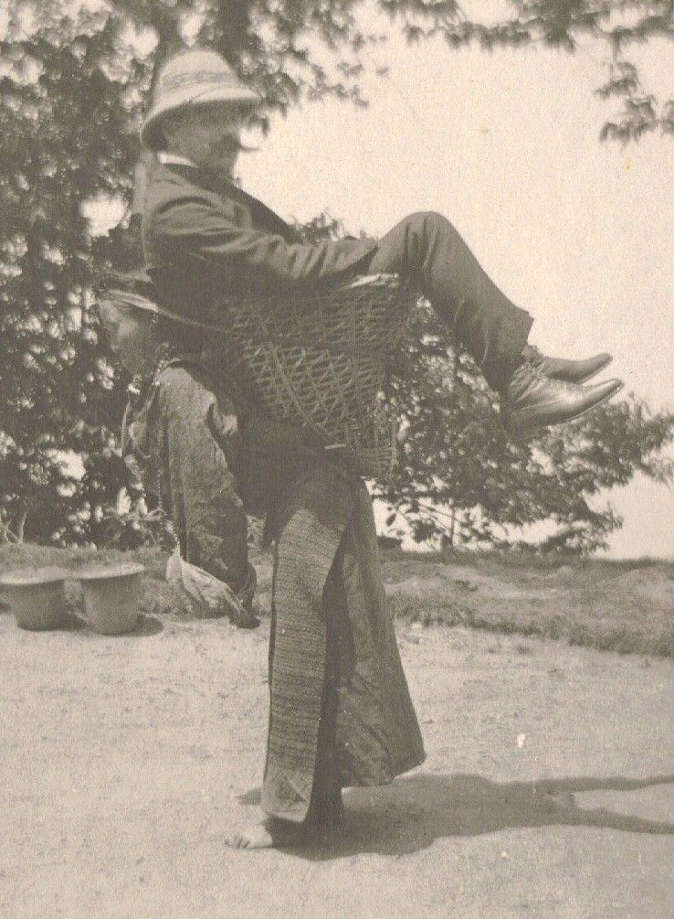 A Sikkimese woman carrying a European man on her back, West Bengal, India, c. 1900 ... uh, so many questions here ...