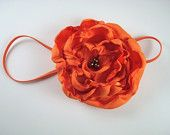Choose Color: Satin Handmade Flower Attached To Taupe Skinny Elastic Headband. $8,00, via Etsy.