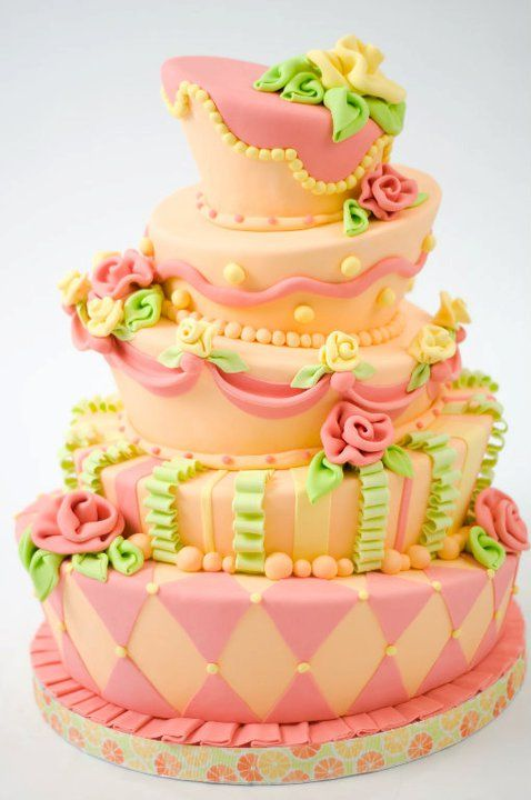 Tropical topsy-turvy wedding cake in pinky coral, yellow, orange and ...