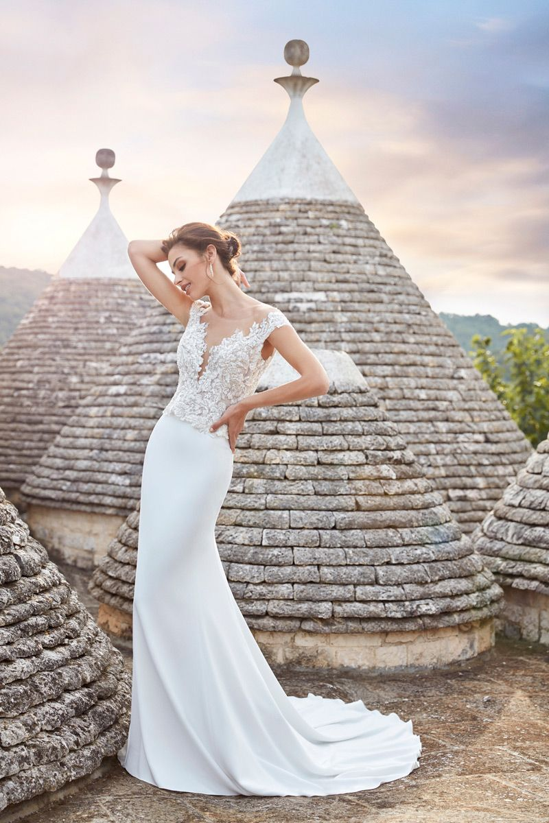Classic Chic This Gown Features A Simple Train And A Beaded