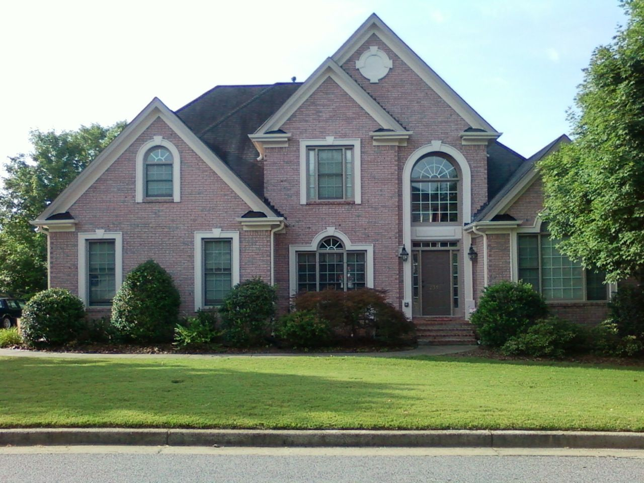 Housing exteriors pink brick house exterior home of mc for Black and white house exterior design